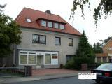 Haus mit drei Wohneinheiten und Ladenlokal